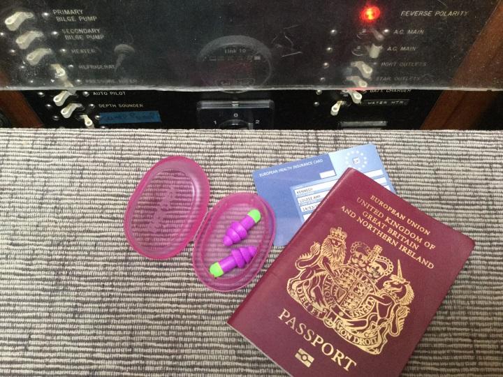 Passport and earplugs